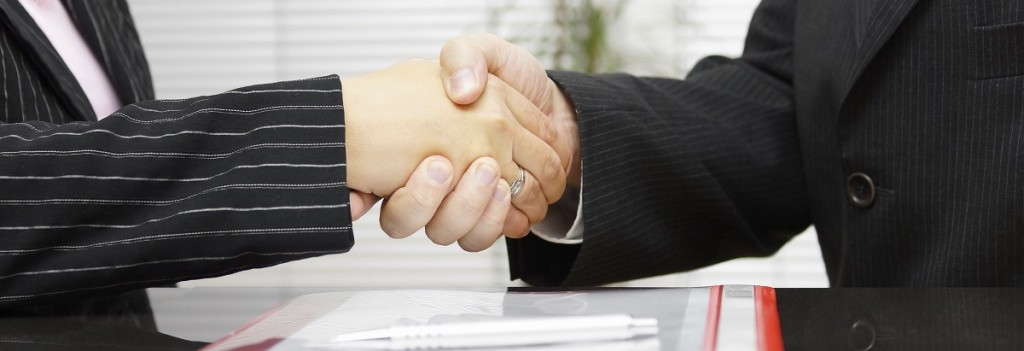 Lawyer and client are handshaking after successful meeting